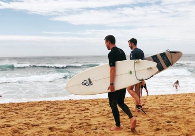 Two Men Going Surfing