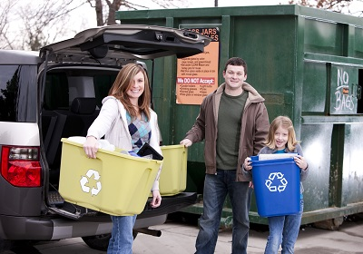 Family taking their recycling to the tip